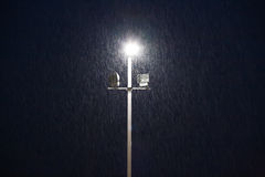 Lights on a sports field at evening in the rain Royalty Free Stock Image