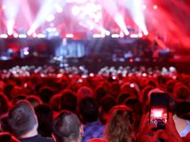 Lights of the stage and audience at live concert. With many people royalty free stock photography