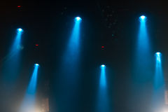 Lights on stage. Blue lights and smoke on stage royalty free stock photo