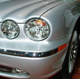 Lights of stlye. Stylish front headlight assembly of a luxury car royalty free stock photos