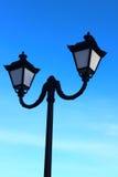 Lights for street lighting. Against the blue sky visible lights for street lighting at night Stock Images