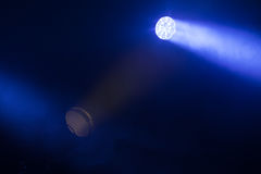 Lights with strong beams in the dark. Colorful scenic spot lights with strong beams in the dark, stage illumination background photo Stock Photos