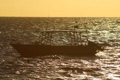 Lights of sunset with a boat, Fiji stock photo