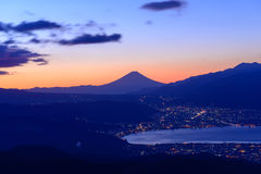 Lights of Suwa city and Mt.Fuji at dawn Royalty Free Stock Images