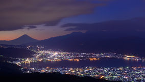 Lights of Suwa city and Mt.Fuji at dawn Royalty Free Stock Photography