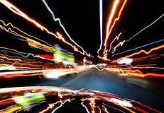 Lights of traffic in-car. Colorful light beams of hectic traffic seen in-car stock photography