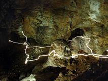 Lights trail in a cave Stock Photos