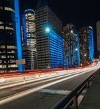 Lights trails of traffic. This is traffics driving along rushing along the Bradfield highway in Sydney you can see the office buildings of the central business Royalty Free Stock Photos