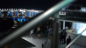Lights Turning in the Night Club near Pool when People Dance Blurred. People dancing in blur in the night outside club when multicolored light turn on and dusk stock footage