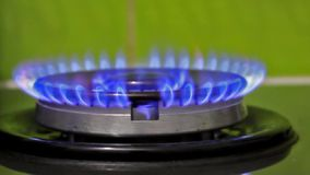 It lights up blue gas on a gas burner stock video