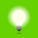 Lights up bulb on a green background  Stock Images