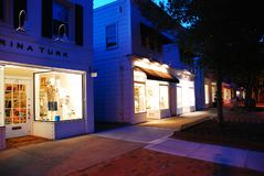 Downtown East Hampton, Long Island. The lights of the upscale stores of East Hampton, Long Island, glow in the dusk sky royalty free stock photo