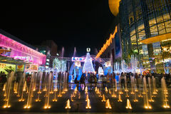 Lights, water and modern building. BANGKOK - 22 DECEMBER: Night illumination of Bangkok, the capital of the Kingdom of Thailand on the eve of Christmas on 22 Royalty Free Stock Images