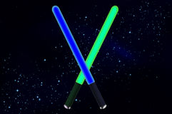 Lightsaber i utrymme vektor illustrationer