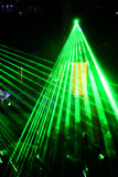 Lightshow. A lightshow with a green laser lights within a disco Royalty Free Stock Images