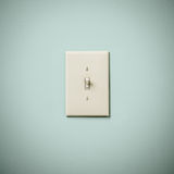 Lightswitch on Blue Green Aqua Teal Wall On Stock Photo