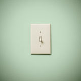 Lightswitch on Blue Green Aqua Teal Wall Off Royalty Free Stock Photos