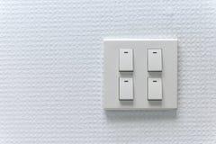 Lightswitch na parede Imagem de Stock