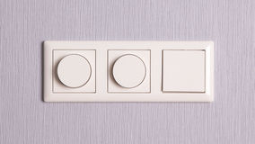 Lightswitches on a grey wall Stock Photography