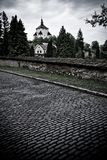 Lighttower over the cemetery. Old lighttower and street made of stone over the cemetery Stock Image