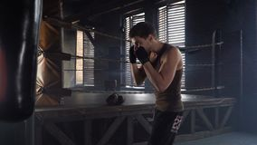 Lightweight boxer punching bag in gym