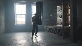 Lightweight boxer training in vintage gym