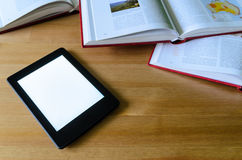 Lightweight e-book (electronic reader) compared to heavy thick b Stock Image