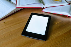 Lightweight e-book (electronic reader) compared to heavy thick b Royalty Free Stock Image