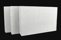 Lightweight foamed gypsum block isolated on black Royalty Free Stock Photography