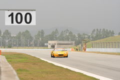 Lightweight Sportscar Challenge. A Lotus was running close to the 100 mark in the Lightweight Sportscar Challenge.  There are total 10 laps in the race 1 and Royalty Free Stock Photography