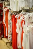 Lightweight summer dress red and white dominant colors, the range on the racks of the boutique store stock photos