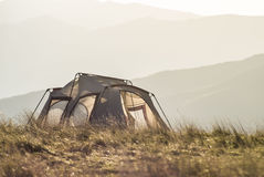 Lightweight tent on a mountain top. Royalty Free Stock Photo