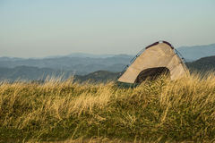 Lightweight tent set up on the side of a mountain. Stock Photo
