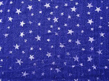 Lightweight vintage fabric, dark blue with shiny silver stars. Royalty Free Stock Image