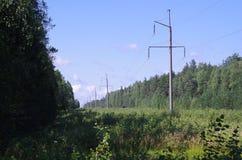 Ligne électrique, poteaux de service Photo stock