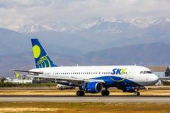 Ligne aérienne Airbus A319 de ciel Images libres de droits