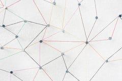 Ligne abstraite connexion de Web de fil de couleur du noeud de clou à incliner la tête images stock