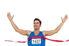 Ligne d'arrivée gaie de croisement d'athlète de gagnant photos libres de droits