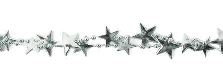 Ligne d'un fil de guirlande d'étoile d'isolement Photos libres de droits