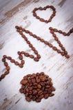 Ligne de cardiogramme de concept rôti de graines de café, de médecine et de soins de santé Photographie stock