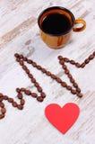 Ligne de cardiogramme des graines de café et de la tasse du concept de café, de médecine et de soins de santé Photos stock