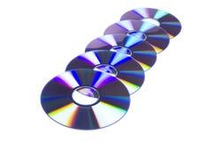 Ligne de cinq disques de DVD Photos libres de droits
