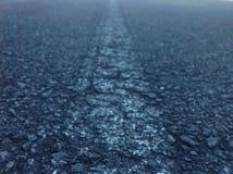 Ligne de route menant dans la distance Photo libre de droits