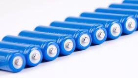 Ligne des batteries bleues Photos stock