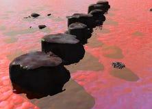 Ligne des pierres de progression dans une scène rouge de fleuve d'océan Photos stock