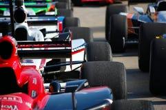Ligne des véhicules d'Indy photos stock