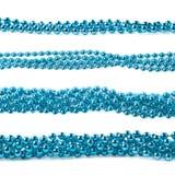 Ligne du fil de guirlande de perles d'isolement Photographie stock