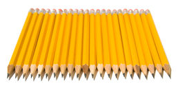 Ligne identique des crayons jaunes Image libre de droits
