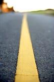 Ligne jaune dans la route Photographie stock