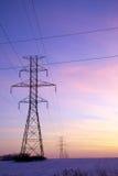 Lignes électriques par la zone d'un fermier avec la neige 02 Images stock